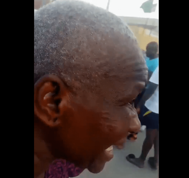 #SarsMustEnd: Police Slaps Elderly Woman For Pointing At Police Station During Protest [Video]