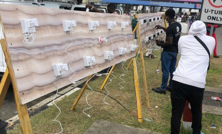 Protesters Get Free Phone Charging Facility At Protest Ground In Lekki Toll Gate