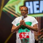 Nigerians reacts as Bovi rocks EndSars-themed outfit to Headies Awards event (Photos)