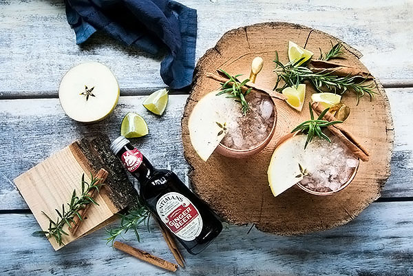 looking down on a bottle of ginger beer with two moscow mules