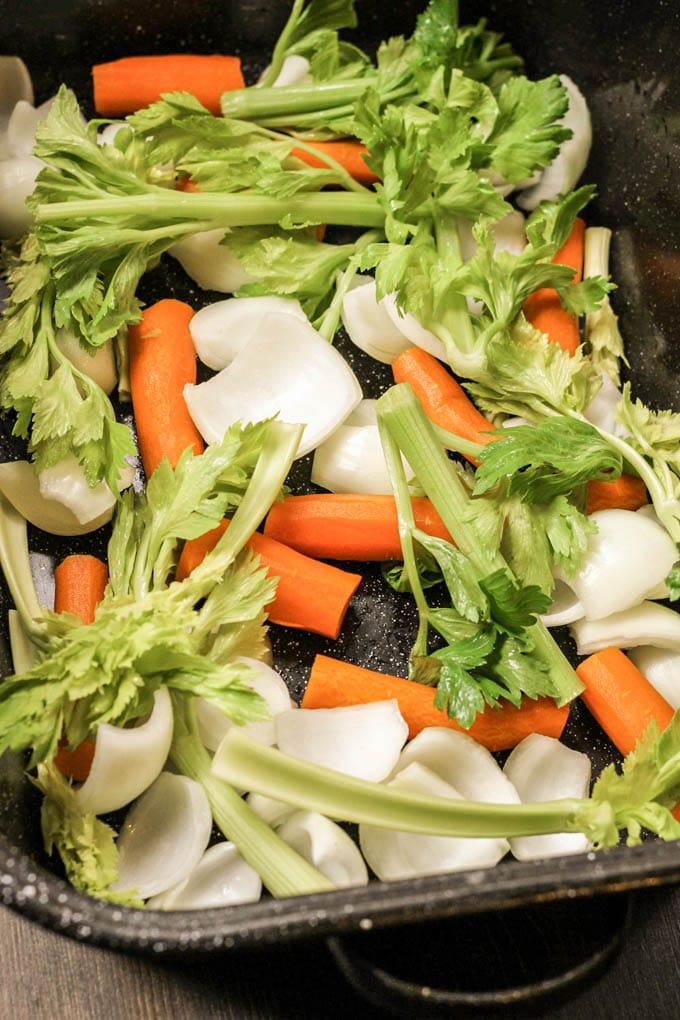 a roasting pan full of veggies