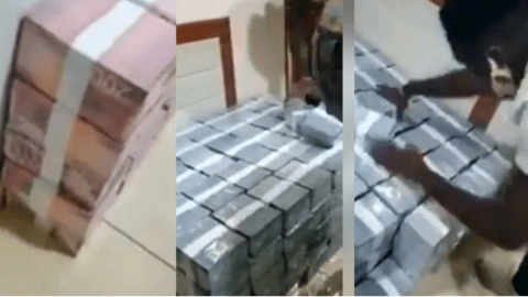 Video of Young boys arranging bundles of cash being packed in their house
