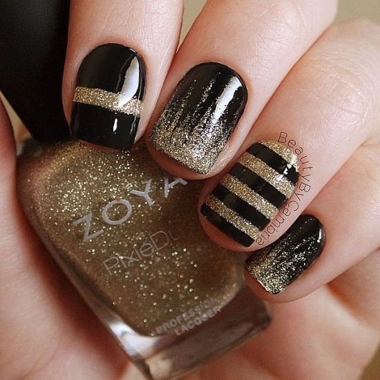 Beautiful Striped Black And Gold Nails