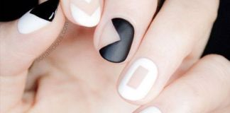 Negative Space Design On Black And White Nails