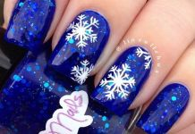 Snowflakes On Blue Gel Nails