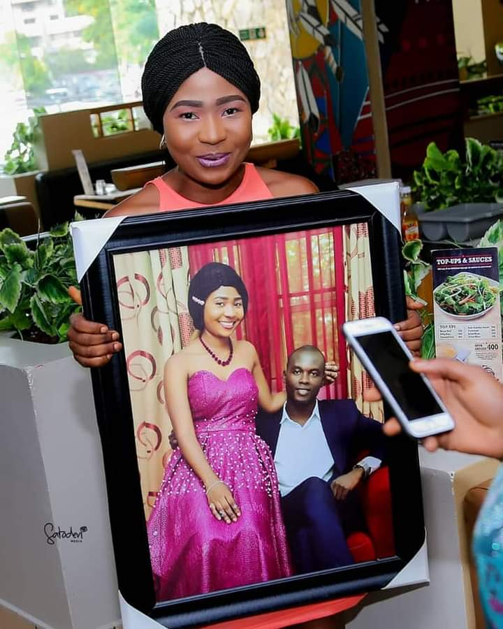 Arewa in a frame with a husband