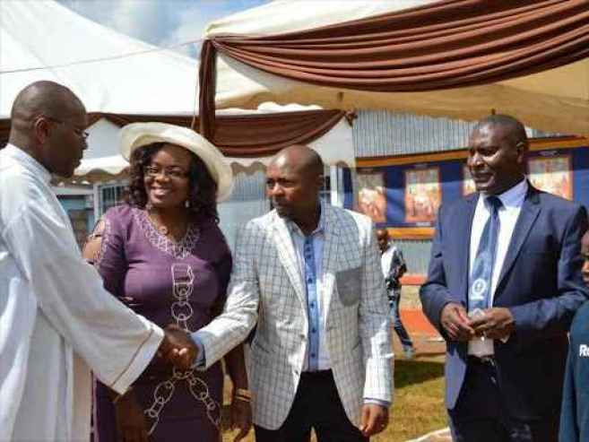 A file photo of kiambu county woman representative Honourable Gathoni WaMuchomba with her husband Robert Mbugua (next to her on the left) and other church leaders.