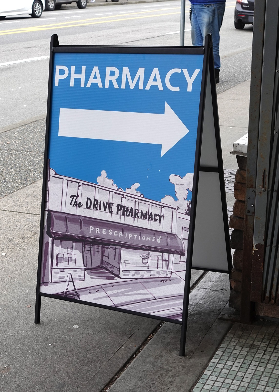 Painting on Sandwich Board for The Drive Pharmacy