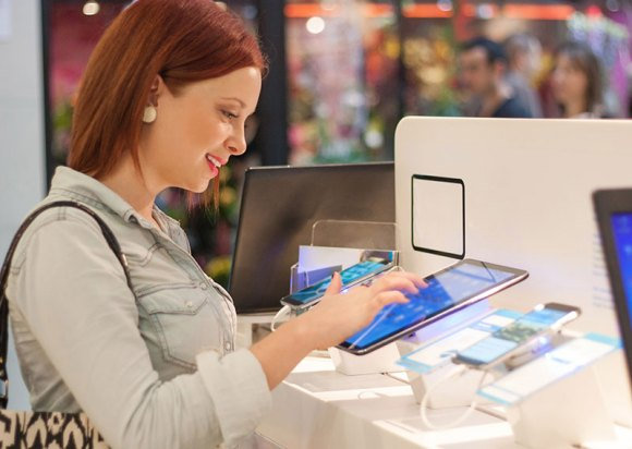 woman testing electronic tablets