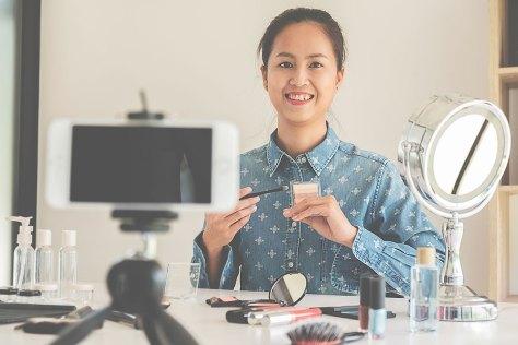 woman doing makeup tutorial vlog