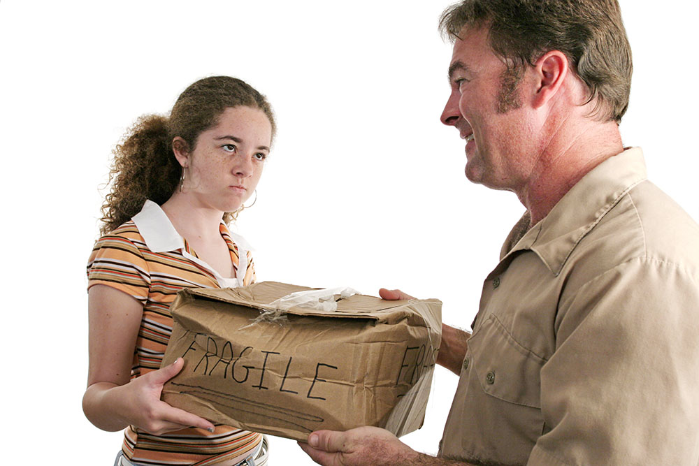 delivery driver handing a smashed package to recipient