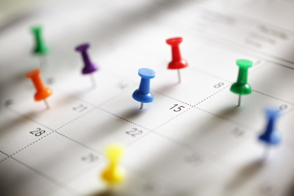 thumbtacks on calendar