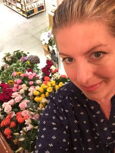 photo of Jill Anne Miller and flowers