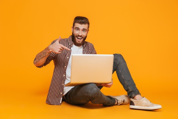 Man pointing to computer, excited about the launch of .dev