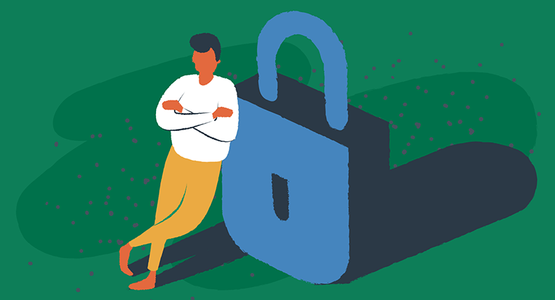 man leaning against a large padlock