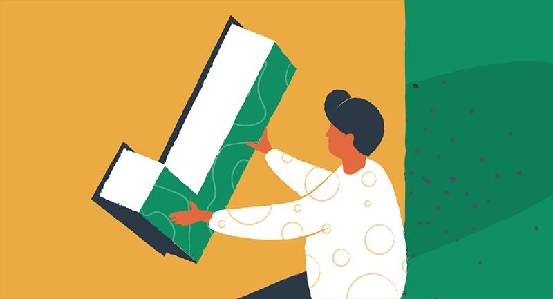 woman placing giant green checkmark