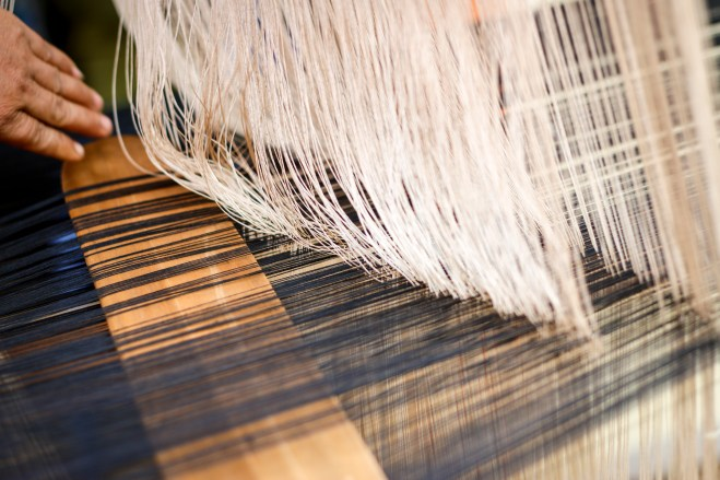 Most houses have a large loom outside, with women at work at the traditional weaving that has been done here for centuries.