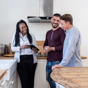 Real Estate Agent Displaying House to Couple