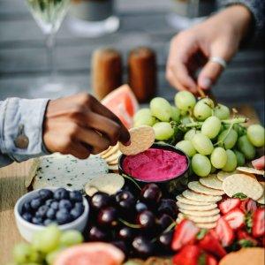 People Enjoying a Fruit & Cheese Platter