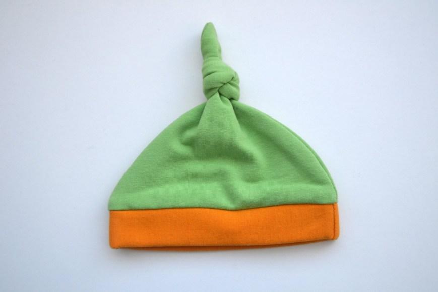 Kepurė naujagimiui - žalios spalvos