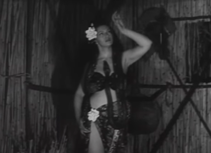 """Zorita dancing with a snake in the movie """"I Married a Savage"""" (1949)."""