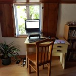 Chair & table with a laptop