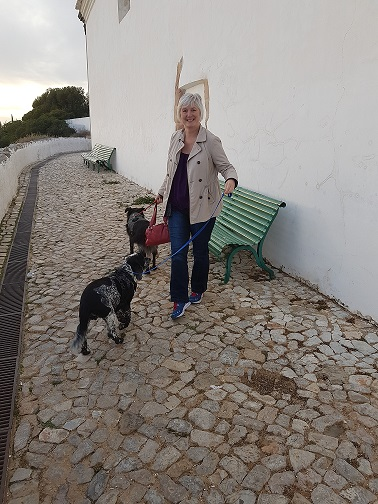 Nancy with two dogs on leads