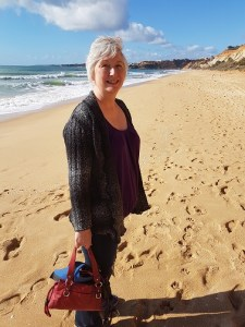 Nancy on a golden beach with blue sky