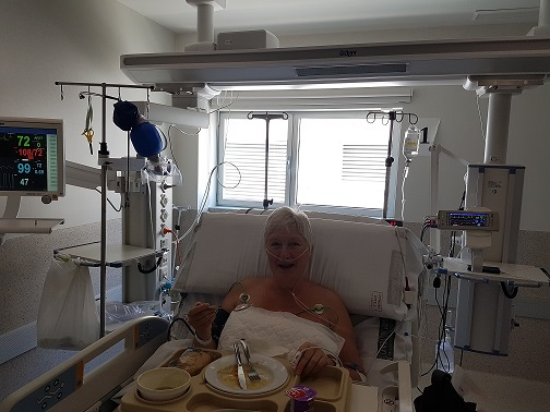 Nancy sat in a hospial bed wired-up to monitors