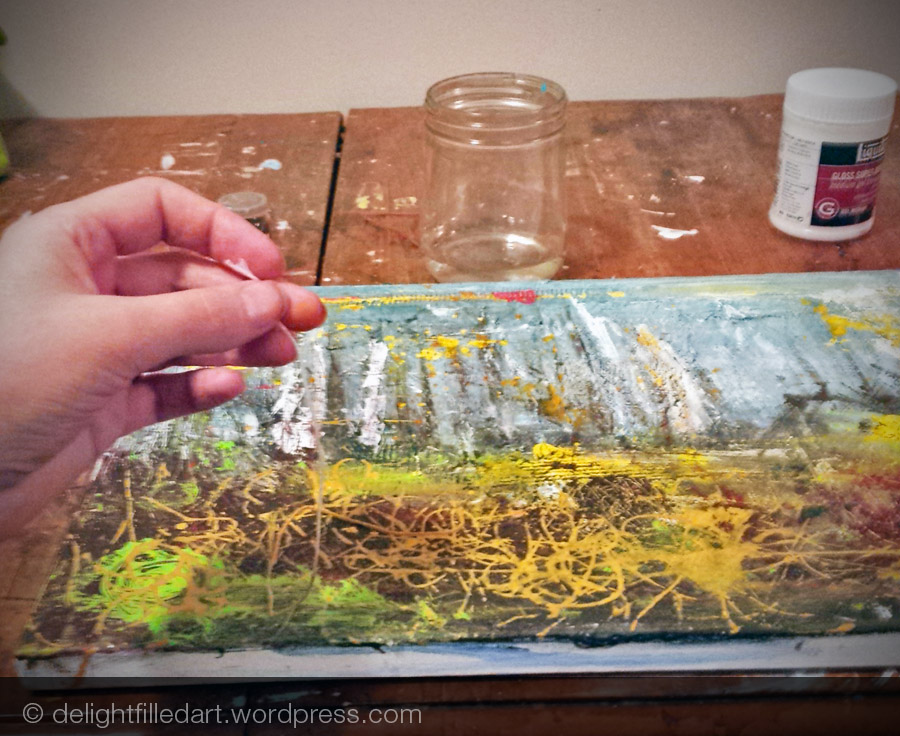 Using paint-soaked string to paint bushes