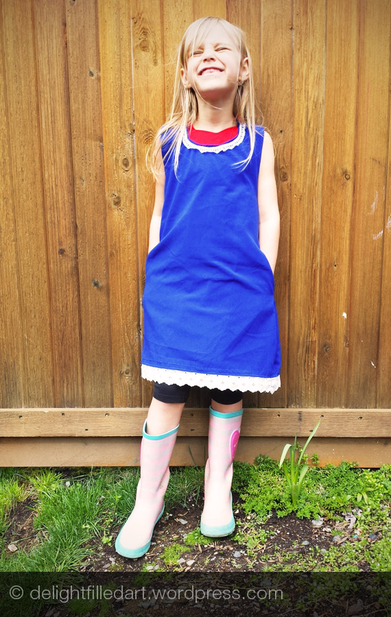 homemade blue girl's dress with white lace