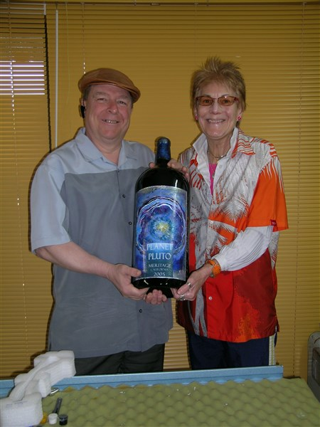 Winemaker Clark Smith and artist Nancy Worthington holding Planet Pluto