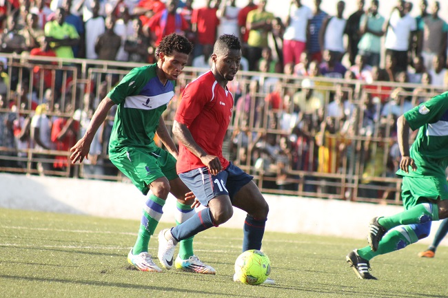 Sekou Jabateh (red shirt) in action for Liberia against Lesotho last Sunday in Monrovia
