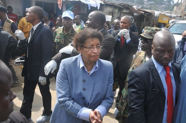 President Sirleaf visits West Point, a slum community hit by Ebola
