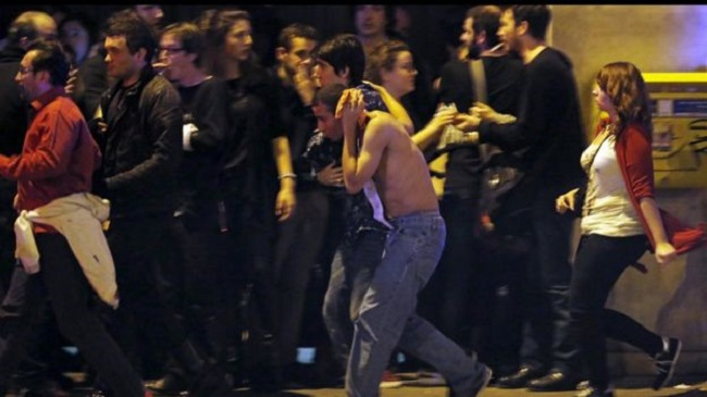 After the attacks: A gathering of people near the Bataclan concert hall where the most deadly attack occurred. Photo: Reuters