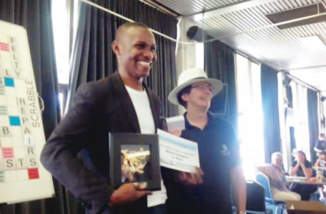 The scrabble world champion Jighere Wellington with the trophy and certificate Photo: Punch