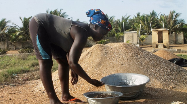 Unable to fish, and with their businesses destroyed, many people in Togo are now collecting gravel to earn a living, further accelerating coastal erosion  © Daniel Addeh/IRIN