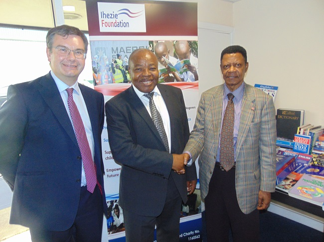 Ihezie Foundation Chair Aloysius Ihezie (middle) shakes with the First Secretary of the Liberia Embassy J. Napoleon Toquie, II