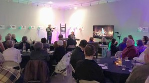 Blues artist Eden Brent performing at museum