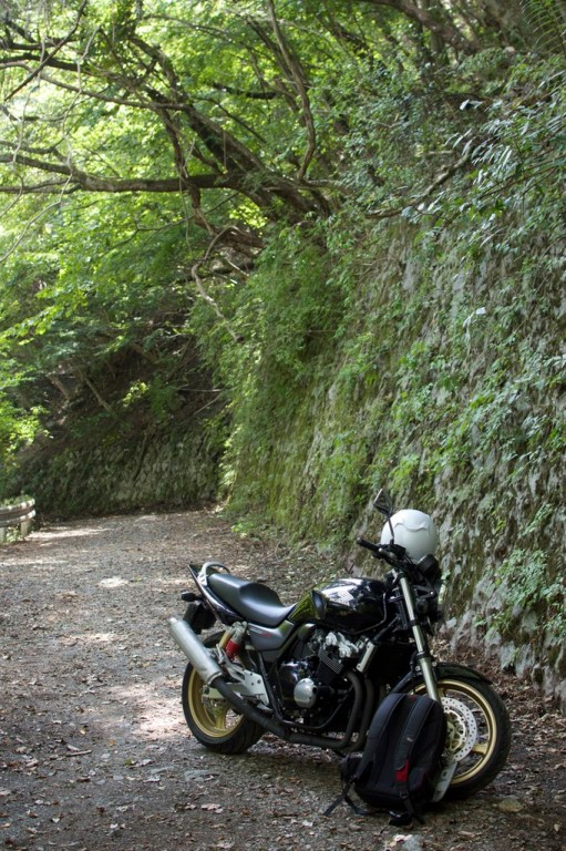 A dirt road where I finally had to stop on my motorbike due to a barrier.