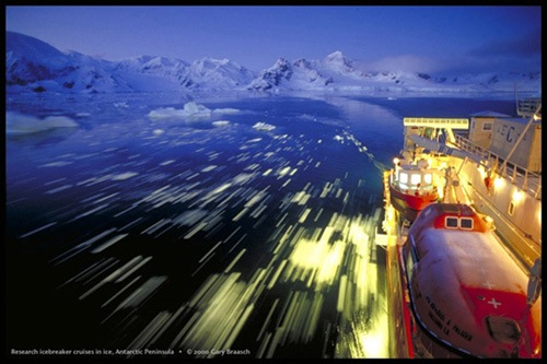 R/V Nathaniel Palmer, largest research icebreaker of the US National Science Foundation, cruises through small ice in pre-dawn light near the Palmer Station, Antarctic Peninsula, April 1999.