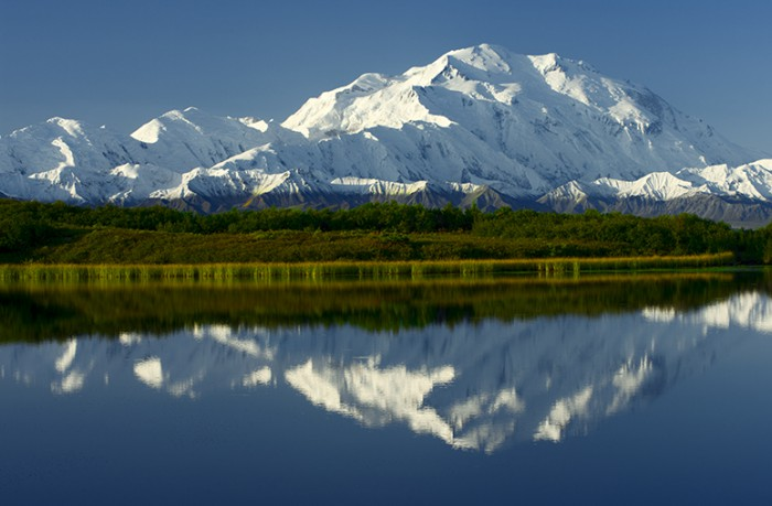 Enormous Denali / Mt. McKinley and its mirror image in Reflection Pond..At over 20,000 feet high, it is the tallest mountain in North America. © Jerry Ginsberg