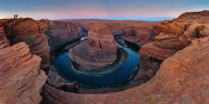 Morning light on sandstone cliffs reflected in the Colorado River at Horseshoe Bend, near Pag, Arizona