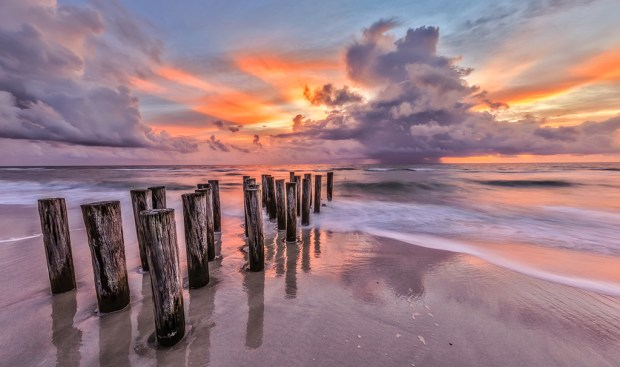 "Showcase 2018 Top 100 winner: ""Pilings, thunderstorm and sunset, Naples, Florida"" © Michael Cohen"