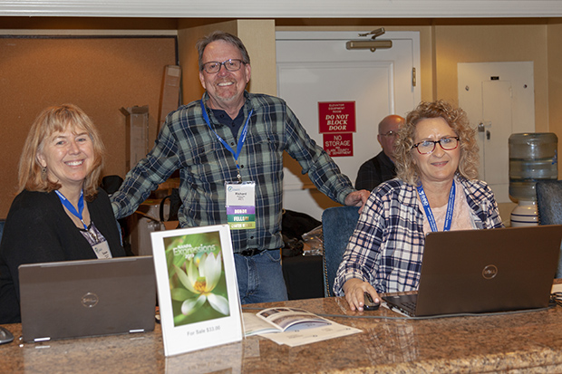 2019 NANPA Summit. Susan Day, Richard Day, and Bethany Brucker at the Registration Desk. Photo © Janice Braud
