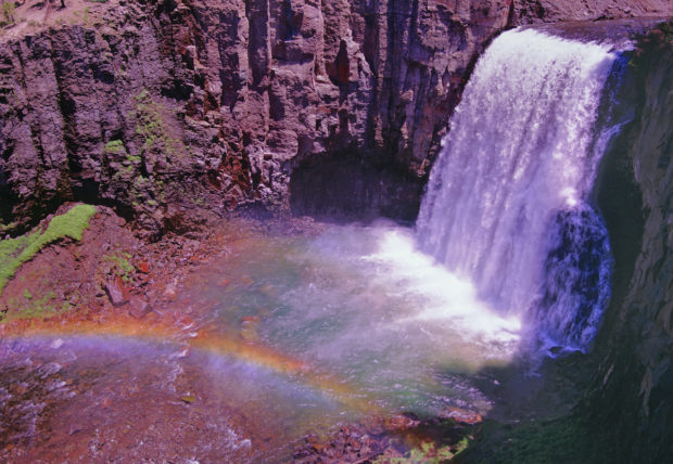 Spilling into the canyon below, Rainbow Falls displays its brilliant spectrum when the sunlight hits its plume of spray.
