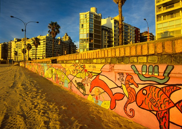 Montevideo's beach on the Rio de la Plata (River of Silver) features a colorfully painted seawall.