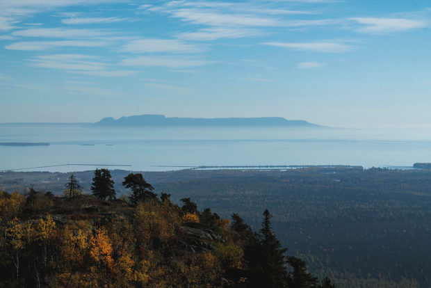 Sleeping Giant. This is probably my favorite landscape photograph, taken in the northern wilderness of Thunder Bay, Ontario. I like the sharp distinction between foreground, middle ground, and background as well as the contrast that the complementary orange and blue hues create. © Nicole Landry.