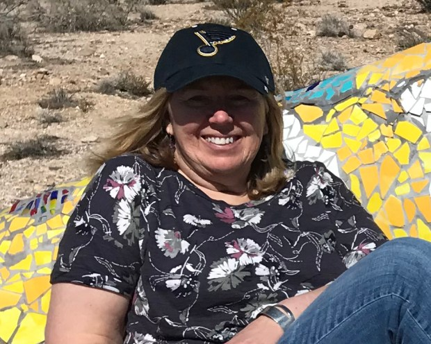 Susan Day relaxing in Rhyolite Ghost Town, NV after 2019 Las Vegas Summit. Photo by Richard Day.