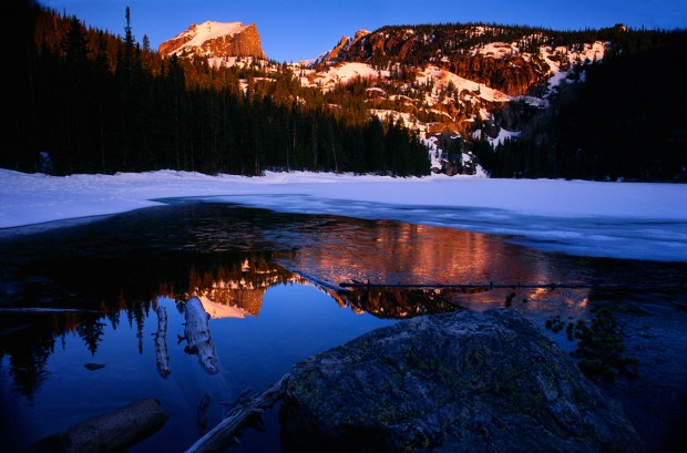 One of the real gems of Rocky Mountain National Park, Bear Lake glistens just after sunrise.